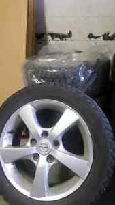 Winter tires. Pnues d'hiver. Mazda. Mags. 16""