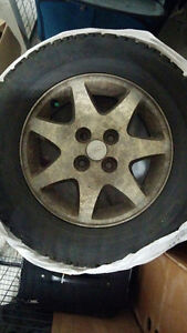 Winter Tires from a 1996 Ford Escort on Rims