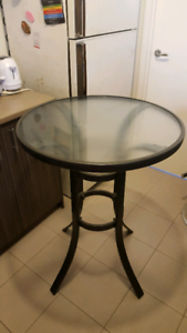 Nice tall glass top table in vgc.