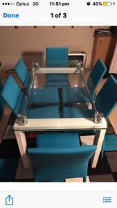 6 Seater Glass table with blue chairs Mount Ousley Wollongong Area Preview