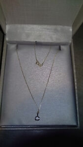 Peoples jeweller yellow gold necklace with a rock diamond