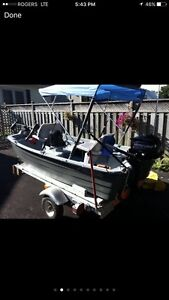 2014 Bass boat,  trailer and 2.5 hp Mercury motor.