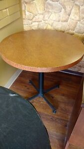 THREE ROUND SOLID WOOD TABLES