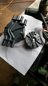 Distributor cap and rotor button