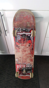 Skateboard with Venture Trucks and Bones Wheels