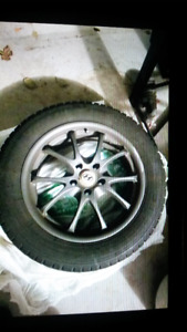 2 Rims and 2 snow tires