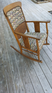 Antique Oak pressed back rocking chair