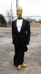 MENS BLACK TUXED0 AND MANICANS