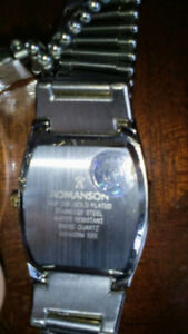 Selling a brand new 23 k gold plated Romanson watch for $180$