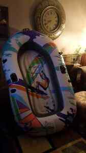 Brand new inflatable 3 person boat and oars.