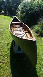 Ceder strip canvas covered canoe