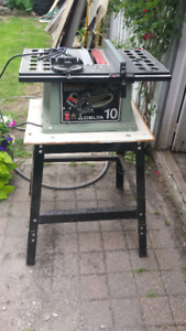 """10"""" Delta table saw and stand with miter gauge and fence."""