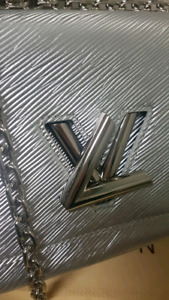 Louis Vuitton silver twist bag with chain. New.