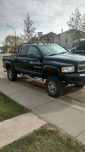 Trade for Avalanche 2005 Dodge Pickup Truck lifted Cummins