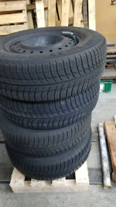 4 GM steel rims with Michelin x-ice 205/70R15 winter tires