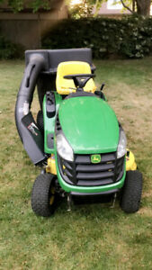 Mint condition! John deer lawn mower with snow plow and vacuum!