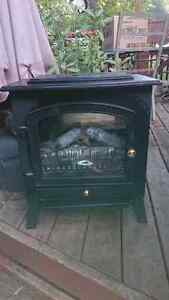 SMALL OLD FASHIONED LOOK ELECTRIC FIREPLACE - $50.00 OBO