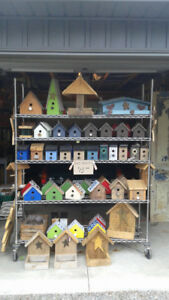 Assortment of birdhouses and bird feeders  for sale