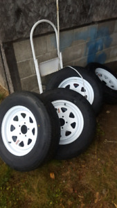 4 new 205/75/15r  trailer tires on 5 hole rims