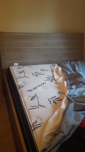 Full-sized mattress + IKEA NYVOLL bed frame