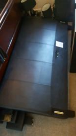 Black leather kingsize bed 2 bed side cabnits 2 lamps