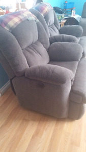 Two matching lazy boy recliners.