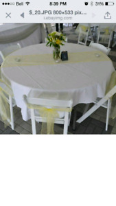 Yellow Organza table runners and chair sashes. Wedding decor