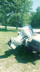 Boat and trailer with 70 horse Evinrude