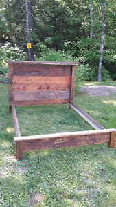 Queen bed made from reclaimed barn materials