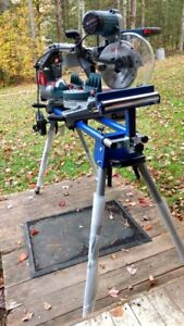 Bosch 10 in. dual bevel miter saw (new-in box) with stand.