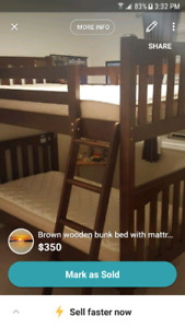 brown wooden bunk bed with mattress