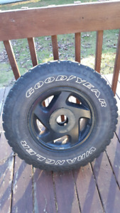 Set of four235/75r15 Good Year Wrangler Territory Tires and Rims