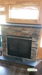 ZERO CLEARANCE PROPANE FIREPLACE.