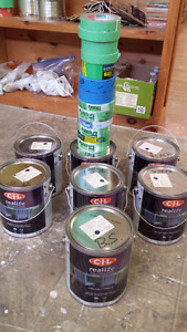 7 unopen cans of black ( & off black ) gallons of paint