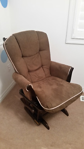 Gliding feeding chair with foot stool