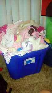 Box of beautiful baby clothes and accessories