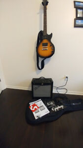 Epiphone guitar and Fender Mustang amp