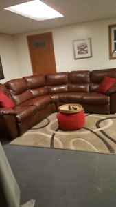Beautiful high end leather sectional double recliners
