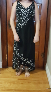 ladies black evening gown with embroidered flowers and wrap