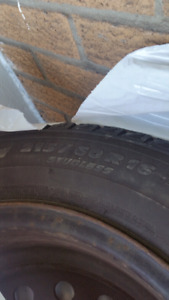 A set of winter tires on rims 215/60/16 perfect condition