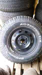Tire and rim for dodge ram.