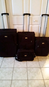 4 piece VIA RAIL dark purple luggage set