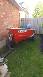 14 ft Aluminum boat with older 18h motor and trailer