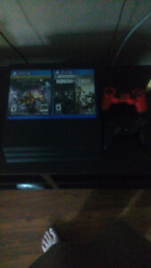 ps4 pro with box and 2 controllers and 2 games
