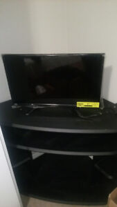 24 inch TV with a TV stand