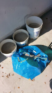 Sand / Gravel..weight for your patio umbrella or basketball net.