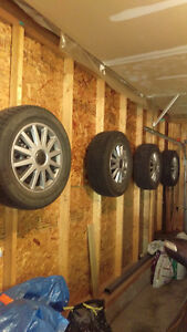 4 winter tires with rims complete with hubcaps