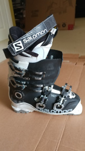 Ski boots for sale with poles thrown in.