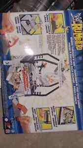 WWE STUFF BRAND NEW IN BOXES