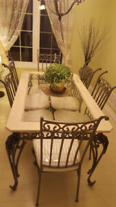 Wrought iron dining table with glass and marble top.